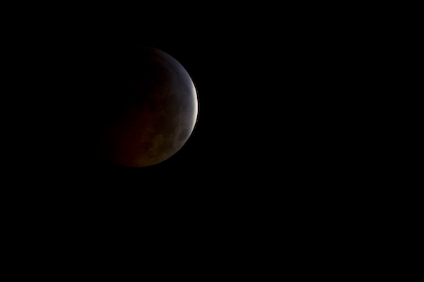 A nearly total lunar eclipse is seen as the full moon is shadowed by the Earth on the arrival of the winter solstice, Tuesday, December 21, 2010 in Arlington, VA. From beginning to end, the eclipse will last about three hours and twenty-eight minutes. Photo Credit: (NASA/Bill Ingalls)